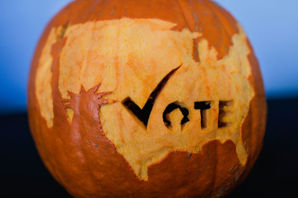 Halloween Pumpkin is showing a statue of liberty symbols or vote.
