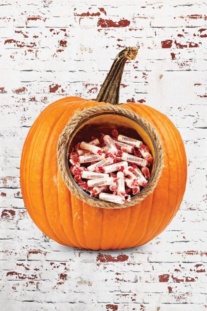 A lot of candy inside of a pumpkin