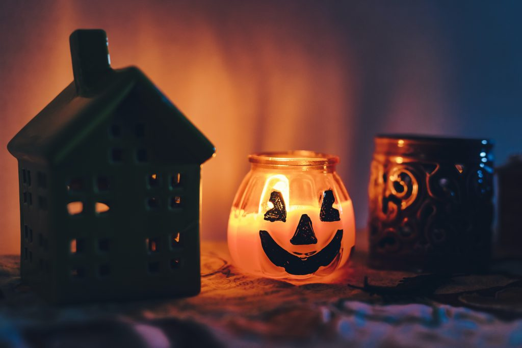 In this frame, tiny house and a little Halloween candle. The tinny candle is growing yellow