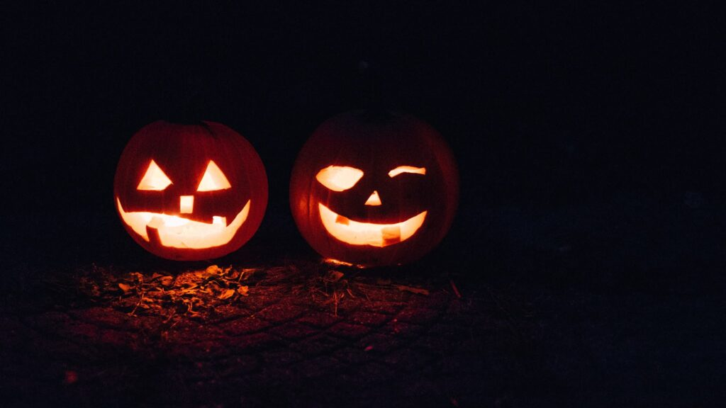 Two pumpkins try to scare you.