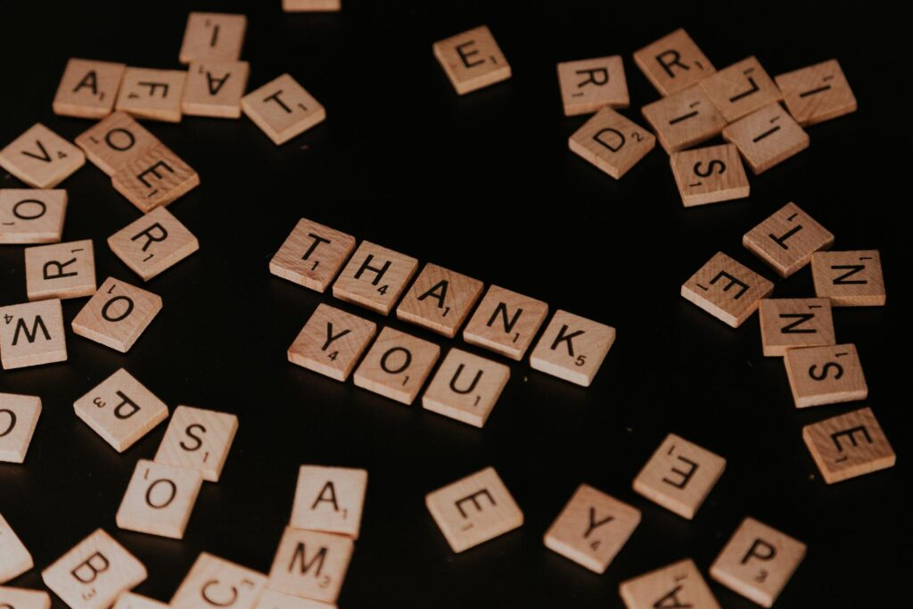 there are a lot of wooden puzzles, and there are saying thank you
