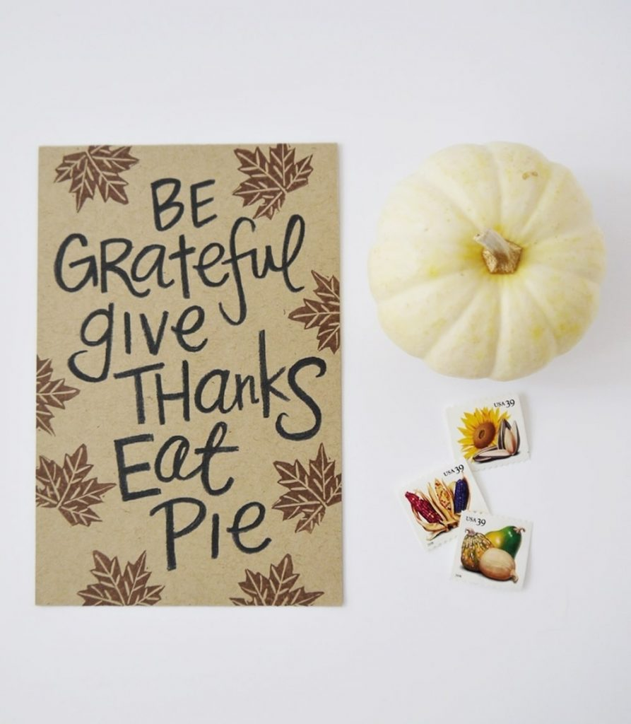 The card says, be grateful, give thanks, eat pie.