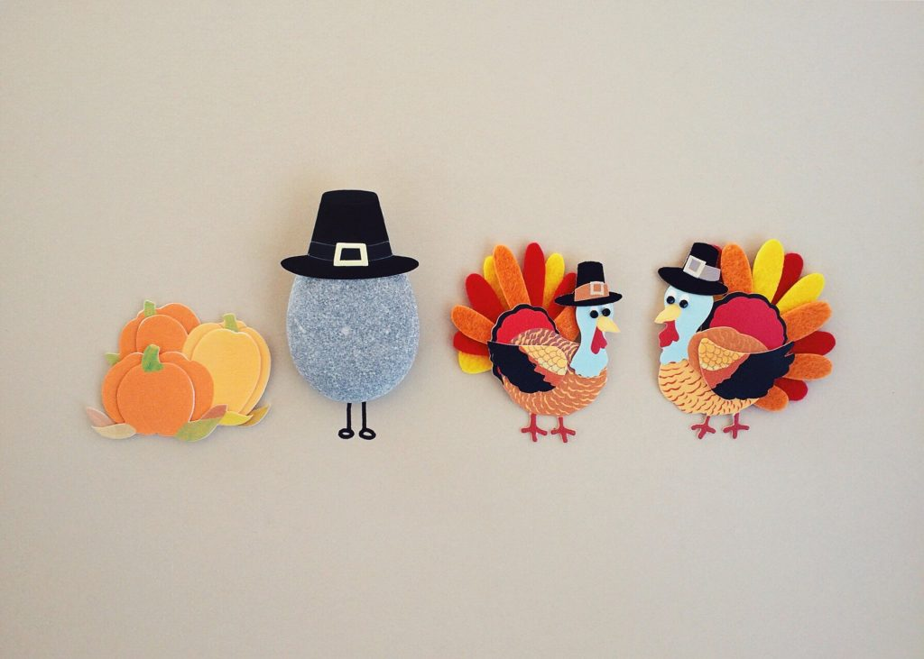 There are two turkeys and one stone, also a pumpkin.